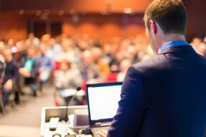 10183596-public-speaker-at-business-conference